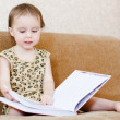 Beautiful cute baby reading a book — Stock Photo #16043673