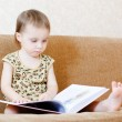 Beautiful cute baby reading a book — Stock Photo #16043869