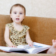 Beautiful cute baby reading a book — Stock Photo #16043897