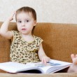 Beautiful cute baby reading a book — Stock Photo #16043899