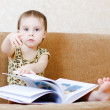 Beautiful cute baby reading a book — Stock Photo #16043903