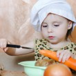 Beautiful cute little cook with vegetables - Lizenzfreies Foto