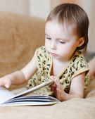Beautiful cute baby reading a book — Stock Photo