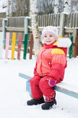 Pretty little girl in winter outerwear — Stock Photo