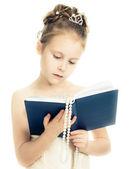Pretty beautiful girl with a prayer book. — Stock Photo
