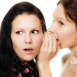 Two girlfriends whispering — Stock Photo #18654317