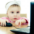Royalty-Free Stock Photo: Cute baby looking into the laptop