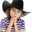 Girl cowboy in a black hat - Stock Photo