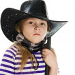 Girl cowboy in a black hat — Stock Photo #18658745
