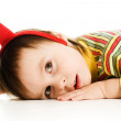 Baby with horns imp sleeps on the floor — Stock Photo #18659873