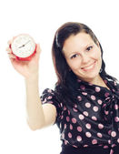Beautiful woman holding a clock . — Stock Photo