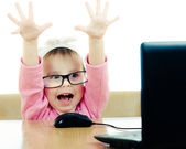 Cute baby with glasses looking into the laptop — Foto de Stock