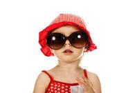 Dziecko w czerwony kapelusz i okulary — Zdjęcie stockowe