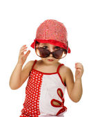 Kid in the red hat and sunglasses — Stock Photo