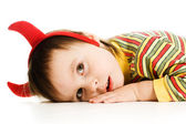 Baby with horns imp sleeps on the floor — Stock Photo