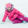 Beautiful happy kid in the red jacket in the winter outdoors. — Stock Photo #21280057