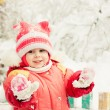 Beautiful happy kid in the red jacket - Stock Photo