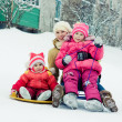 Mother with children on the sled. — Stock Photo