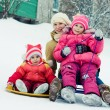 Mother with children on the sled. — Foto Stock
