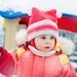 Beautiful happy kid in the red jacket — Stockfoto