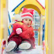 Beautiful happy kid in the red warm clothing. — Stock Photo