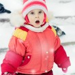The kid in red jacket winter. — Stock Photo #23217400