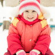 Little girl in a red jacket — Stock Photo #23217594