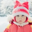 The kid in red jacket winter. — Stock Photo #23218112
