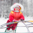 Beautiful happy kid in the red warm clothing — Stock Photo