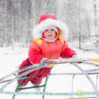 Beautiful happy kid in the red warm clothing - Stock Photo