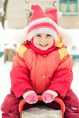 Little girl in a red jacket — Stock Photo