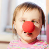 Kid with red nose — Stock Photo