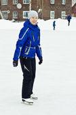 Girl in skates at the rink. — Stock Photo