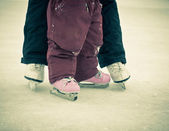 Child and parent feet on skates — Stock Photo