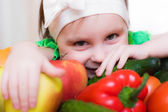 Happy Kid with vegetables and fruits. — Stock Photo