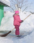 Girl with a broom — Stock Photo