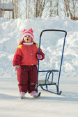 Happy kid skating and sledding in winter outdoors — Stock Photo