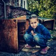 Sad poor child in the ruins — Stock Photo