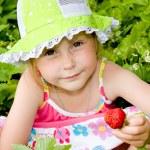 Girl eating strawberries — Stock Photo #3812436