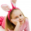 The little girl with pink ears bunny on white background. — Stock Photo #8787736