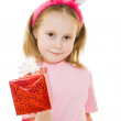 The little girl with pink ears bunny with a gift on a white background. — Stock Photo #8787778