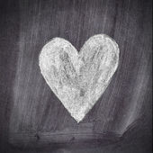 Heart shape chalk drawing on chalkboard blackboard — Stock Photo
