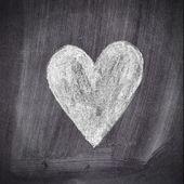 Heart shape chalk drawing on chalkboard blackboard — Stock Photo