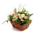 Basket with beautiful flowers isolated — Stock Photo