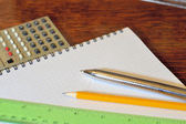 Table and pens — Stock Photo