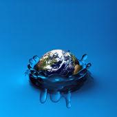 Earth falling in water — Stock Photo