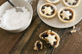 Eating delicious fresh baked Christmas mince pies — Stock Photo