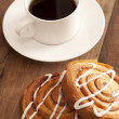 Cup of hot espresso coffee with fresh buns — Stock Photo #42699915