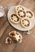Eating tasty home baked Christmas mince pies — Stock Photo