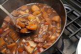 Delicious beef stew cooking in a pot — Stock Photo